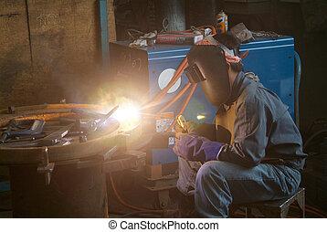 Welder at work - Welder working at a mechanical workshop