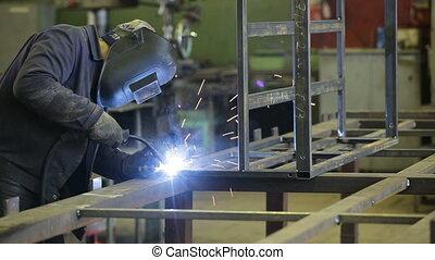 Welder at work - Welder working a welding metal with...