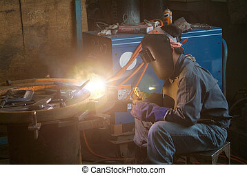 Welder at work - Welder working at a mechanical workshop