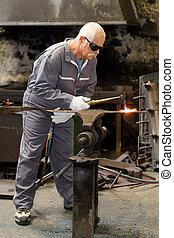welder busy doing his work