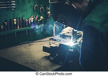 Welder Fusing Metal Together