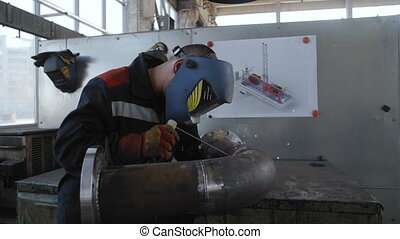 Welder in Workshop Work with Pipe