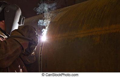 welder performs welding large diameter pipe - Welding during...