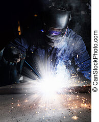 welder man in a mask doing the work