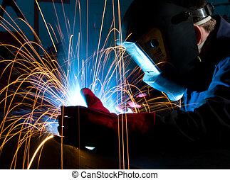 Welder shielding sparks from metal - Welder bent over metal...