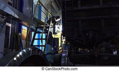 Welder solders something in the service depot - Welder...