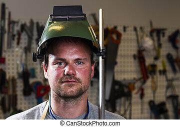 welder wearing helmet at work place
