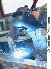 welder welding a material