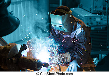welding - welder welding metallic parts