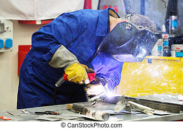 welder welds the metall components