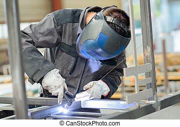 welder with blow torch
