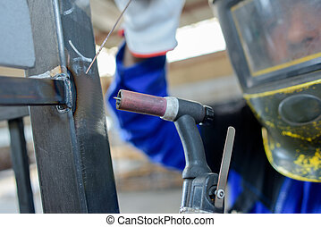 welder with metal frame