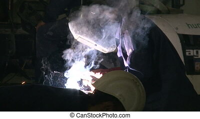 Welder with Welding Electrode - Shots of civil works....