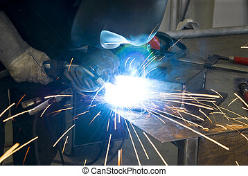 welder with workpiece and alot of sparks
