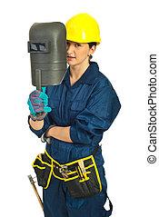 Welder woman holding welding mask