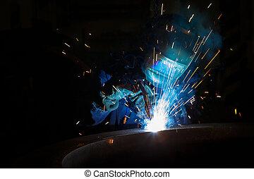 Welder worker is welding a big valve  body