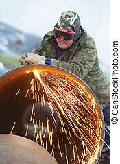 Welder worker with flame torch cutter