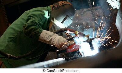 Welder working in factory