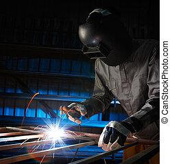 welder working - man welding in workshop with safety...