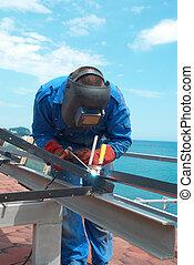 Welder working with metal construction - Welder at the...