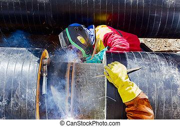 Welders working on a pipeline.