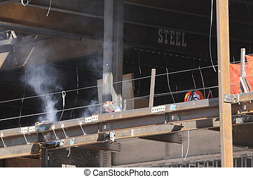 Welders working on large construction