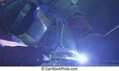 Welding a steel parts with gas arc welding - Welding a steel...