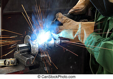 Welding - Closeup photo of arc welding of a steel shaft with...
