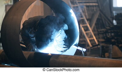 Welding Engineer weld for the creation of pipes.a lot of...