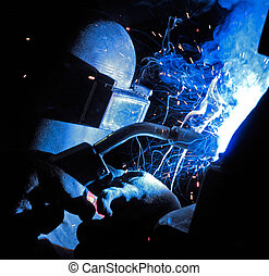 WELDING INDUSTRIAL STEEL - Sparks, Steel and smoke from...