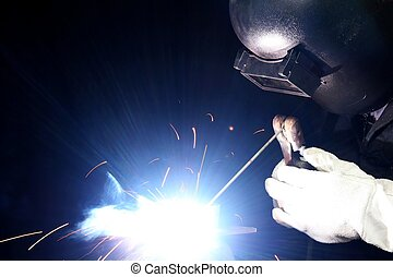 Welding Light and Sparks - Blue smoke and bright light from...