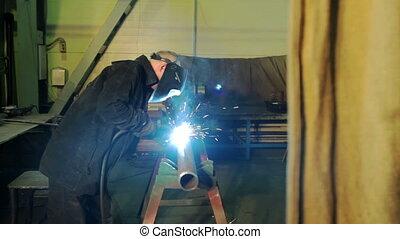 Welding process in industrial factory