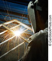 welding in progress, focus on the sparks