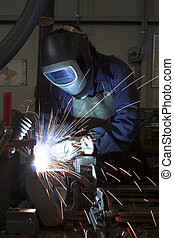 Welding welding a metal part in an industrial environment -...