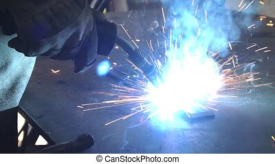 Welding  - welding with blue flames