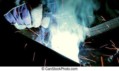 Welding with sparks - Welding with orange sparks on black