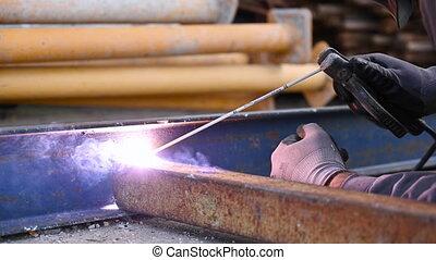 Welding work, Man Welding in Workshop. Metalwork and Sparks...