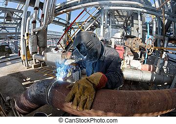 Welding works at installation of new pipeline - Welding...