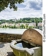 Well and riverside in Passau - Image of a small well, river...