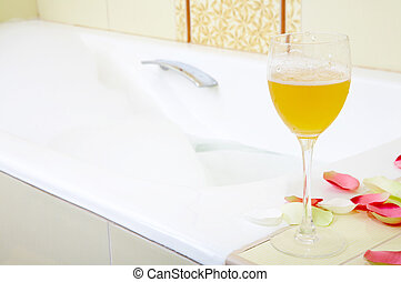 Well-being - Still-life a glass with a drink against a bath...