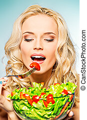 well being - Portrait of a beautiful young woman eating...