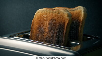 Well Done Toast Is Taken From Toaster - Slices of toast pop...