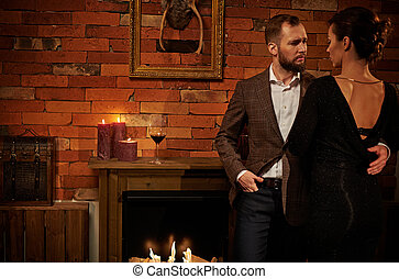 Well-dressed couple in cozy home interior
