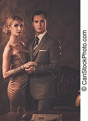Well-dressed couple in retro interior