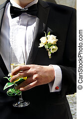 Well dressed groom with a funny ladybird cufflink on his sleeve