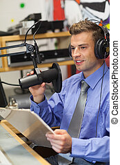 Well dressed happy radio host moderating