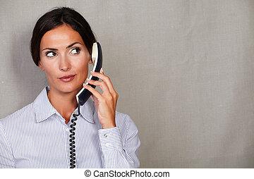 Well-dressed secretary speaking on the phone