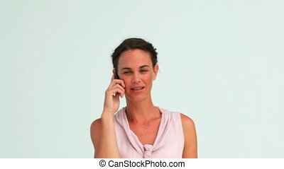 Well-dressed serious woman on the phone in studio