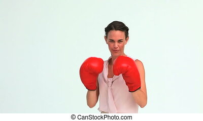 Well-dressed woman boxing in studio