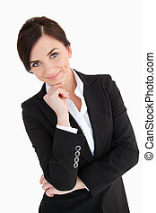 Well-dressed woman with blue eyes against white background